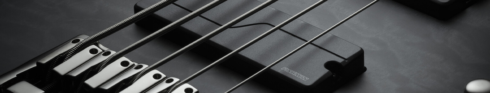 Close up of one Fluence 5 string soapbar bass pickup mounted in electric guitar