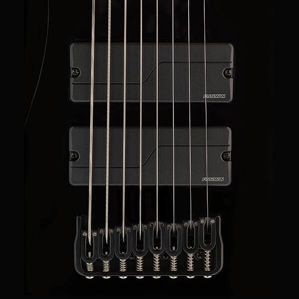 close up of Fluence Modern pickups on black 8-string guitar