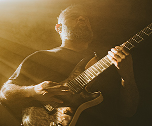 Javier Reyes playing electric guitar with Fluence pickups on stage