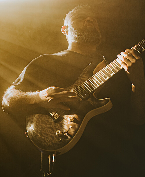 Javier Reyes playing guitar with Fluence pickups on stage