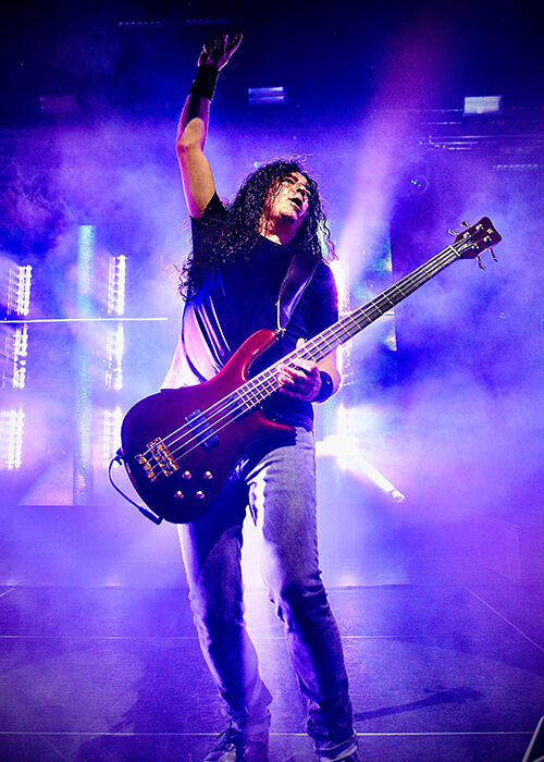 Mike Inez performing bass on stage with Fluence pickups