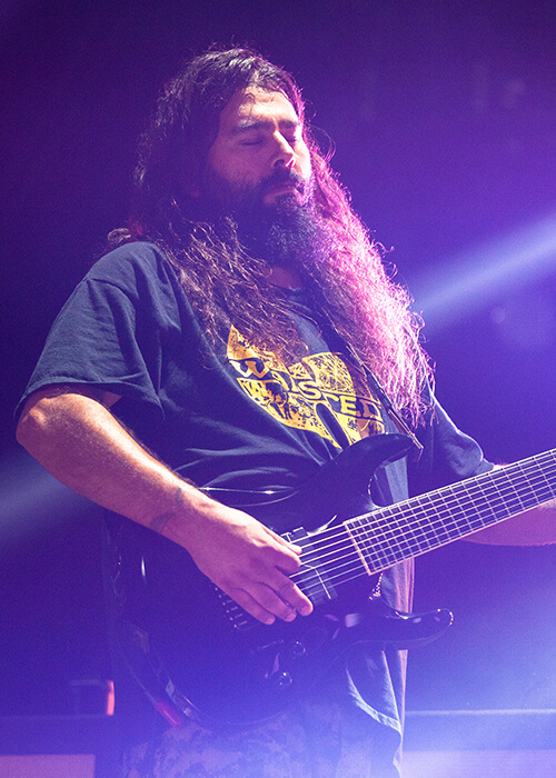Stephen Carpenter playing guitar with Fluence pickups on stage