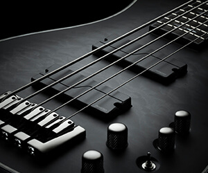 close up of electric bass body with Fluence pickups