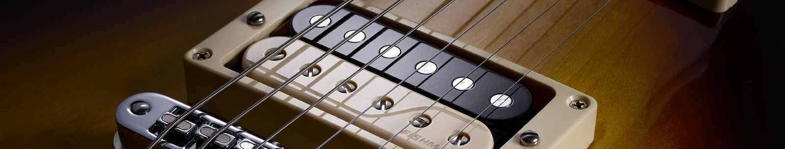 close up of Fluence Open Core Classic humbucker zebra bridge pickup in guitar
