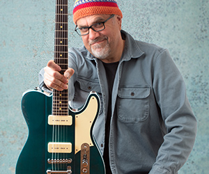 Greg Koch posing with electric guitar with Fluence pickups