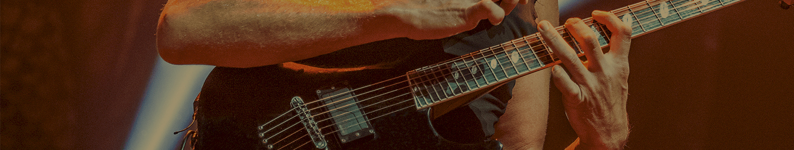 close up of guitar player playing electric guitar with Fluence pickups