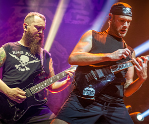 Killswitch Engage band playing electric guitar with Fluence pickups on stage