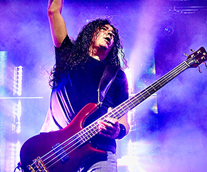 Mike Inez playing electric bass with Fluence pickups on stage