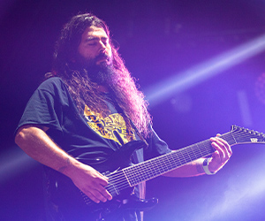 Stephen Carpenter playing electric guitar with Fluence pickups on stage