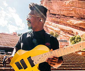 Tosin Abasi posing with electric guitar with Fluence pickups